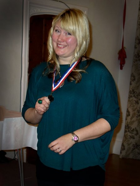 Charlotte receiving her award from the Bowmen of Danesfield