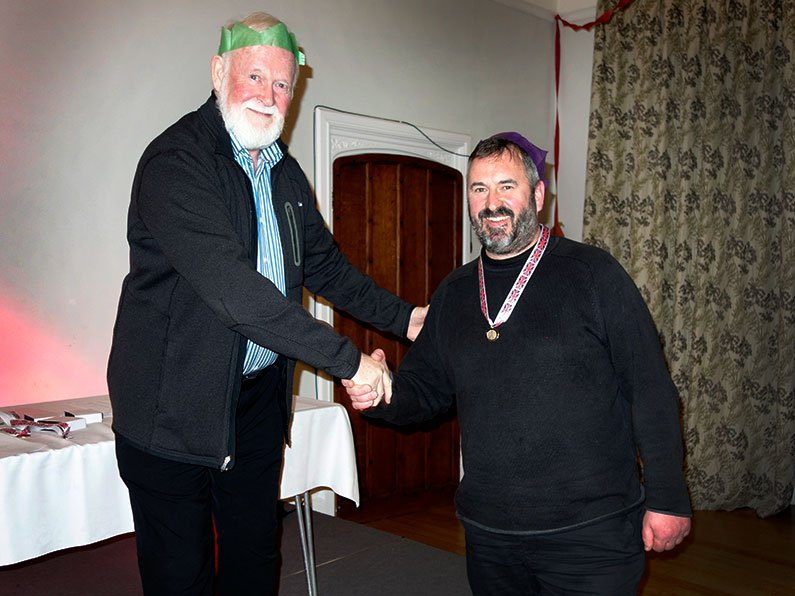 Gerry presenting an Archery award to Courtenay at the Bowmen of Danesfield Christmas Dinner