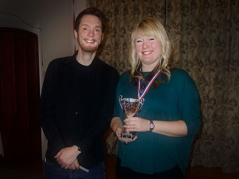 Ian and Charlotte receiving their award from the Bowmen of Danesfield