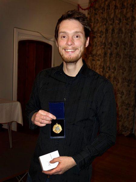 Ian receiving his award from the Bowmen of Danesfield