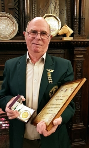 Doug-Human-holding-centenary-medal-and-certificate-bowmen-of-danesfield-kevin-king-001
